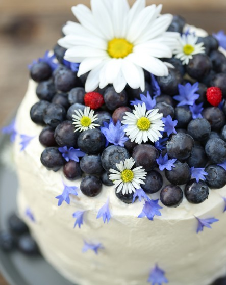 gluten free midsummer cream cake with fresh berries and lemon custard