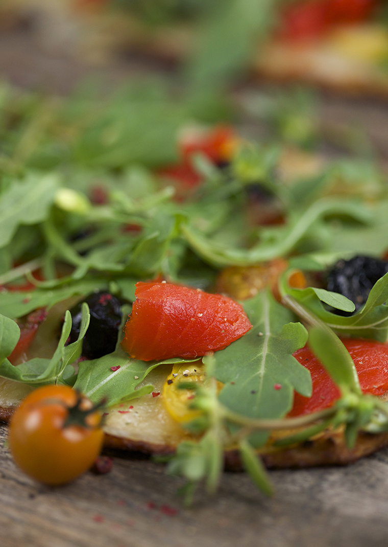 Gluten free cauliflower pizza with olives & smoked salmon - photo philip blankenship